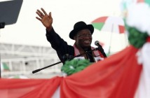 Nigeria's President Goodluck Jonathan wave at supporters on Tuesday during his declaration to seek a second term in a February 2015 presidential election