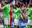 VfL Wolfburg's Ricardo Rodriguez celebrates with teammates after scoring against Bayer Leverkusen during the German Bundesliga first division soccer match in Wolfsbur