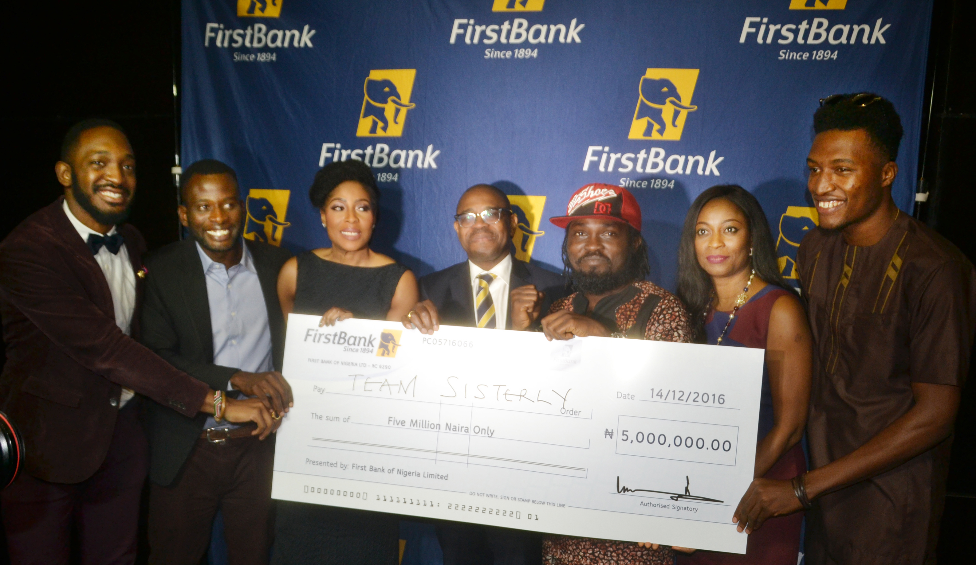 Deputy Managing Director, FirstBank, Gbenga Shobo (Middle); Executive Chairman and CEO of EbonyLife TV, Mo Abudu ( third left); Group Head, Marketing and Corporate Communications, FirstBank, Folake Ani-Mumuney (second right) presenting the star prize to the winners of the FirstBank FirstStars Reality TV show (Team Sisterly) .