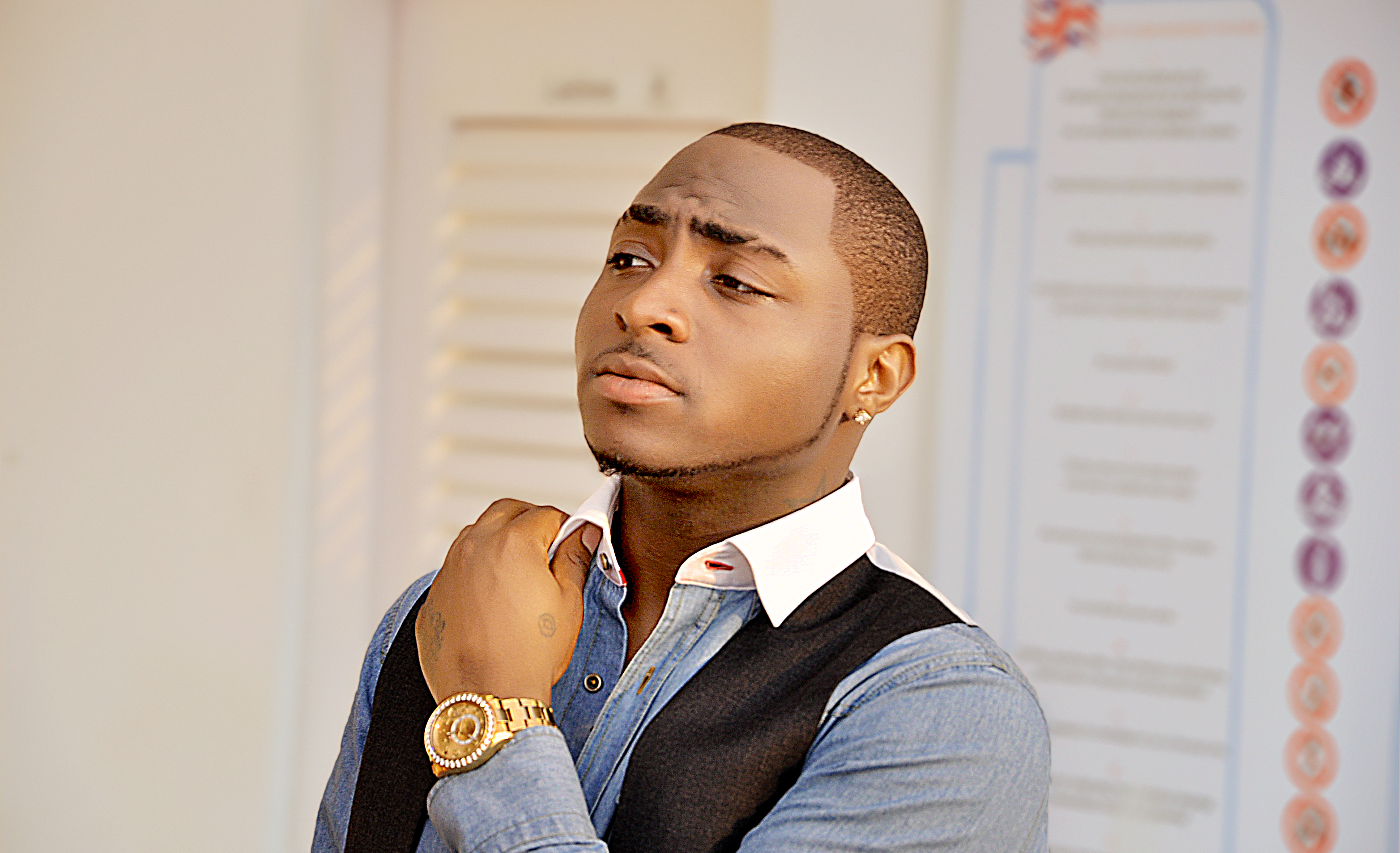 Davido Shares Childhood Photo With His Mum And DadDavido Shares Childhood Photo With His Mum And Dad